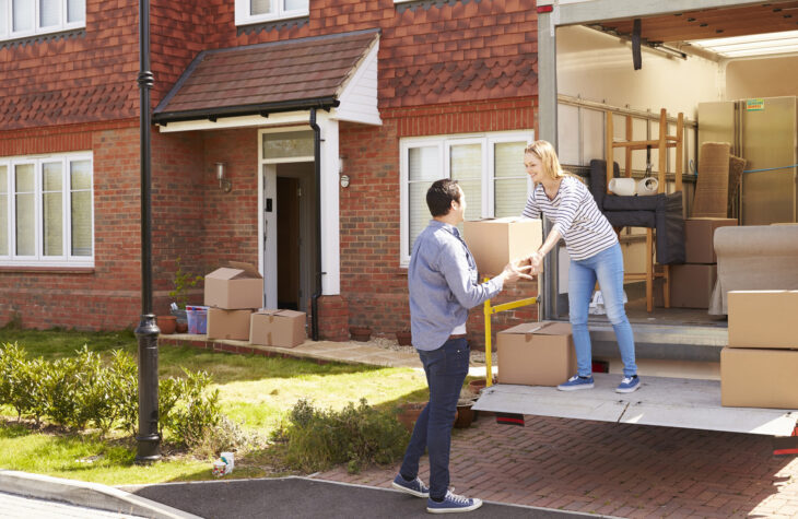 couple just sold their house and are packing to move
