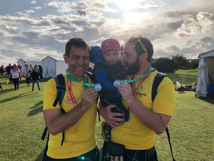 At the finish line in Dundee, Fraser and Chris are met with smiles from Fraser's son, Angus.